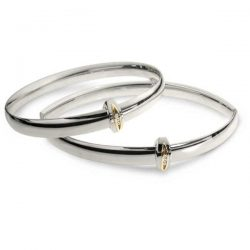 Diamond runner bangles in silver and gold