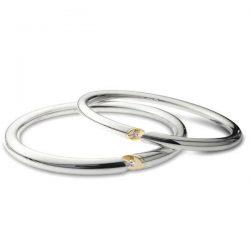 Diamond slice bangles in silver and gold