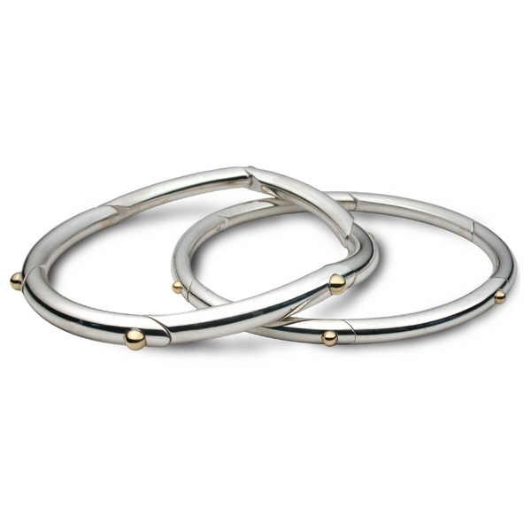 Unusual silver bangles with gold bead detail