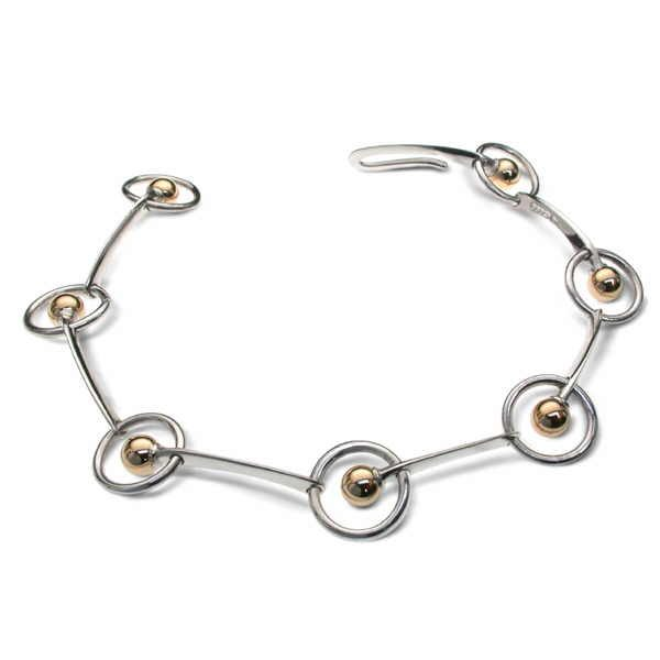Bead and hoop bracelet in silver and gold