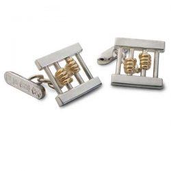 Jail-bird cufflinks in silver and gold