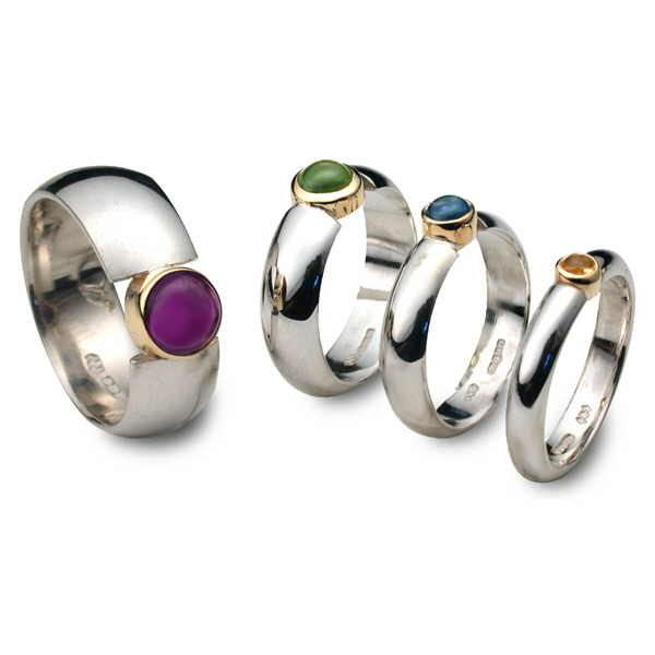 Cabochon set rings in silver and gold