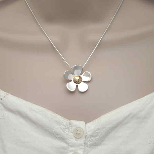 large daisy pendant on neck