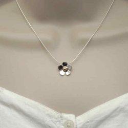 small daisy pendant on neck