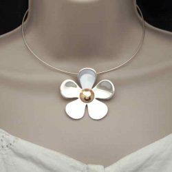 Monster daisy pendant on neck