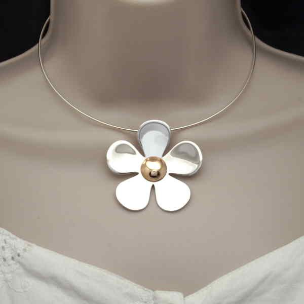 Monster daisy pendant on neck