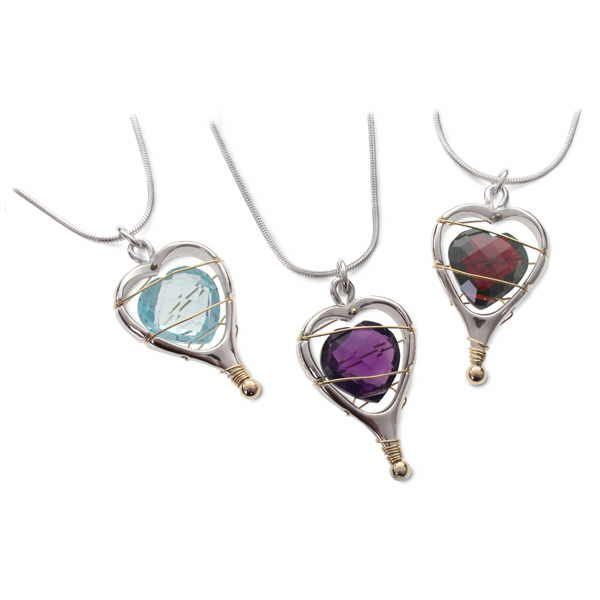 Captive heart pendants in silver and gold