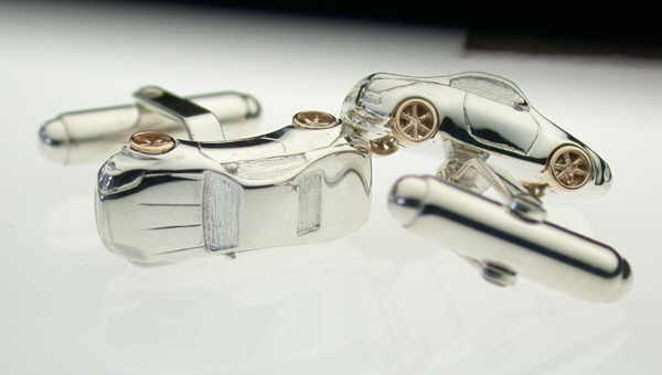 Nissan cufflinks in silver and gold