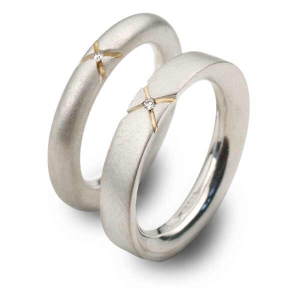 Diamond kiss rings in silver gold and diamonds