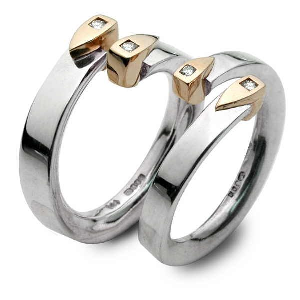Gold flame rings set with diamonds
