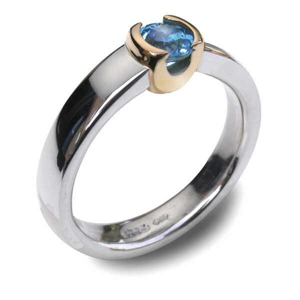Gold cup ring in silver and gold with blue topaxz