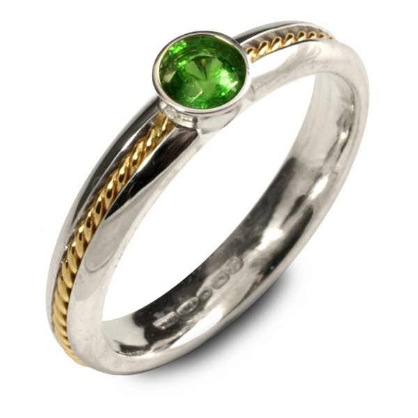 Unusual silver and gold ring set with tsavorite garnet
