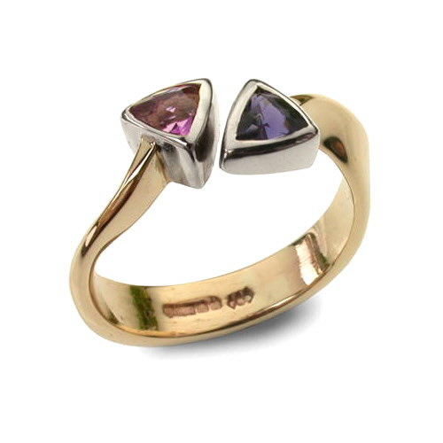 Trillion ring in gold with gemstones
