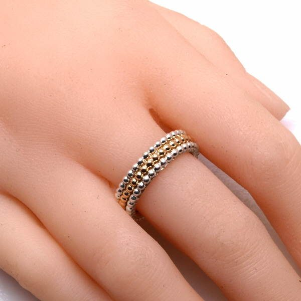 Silver and gold stacking rings on hand