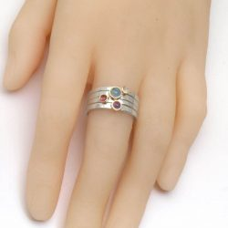 gem set stacking rings on hand