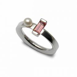 An unusual silver ring set with pink tourmaline and pearl