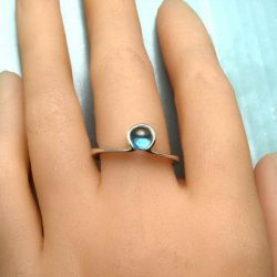 Silver omega ring on hand