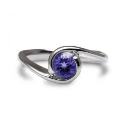 Orbit ring with iolite and diamonds